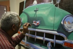 Picture: Local artist Pat Henry puts some finishing touches on a painting.